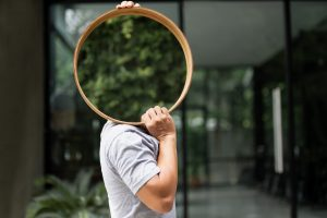 Man carrying mirrors for house decoration