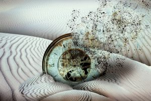ancient clock disintegrating buried in desert sand, end of time